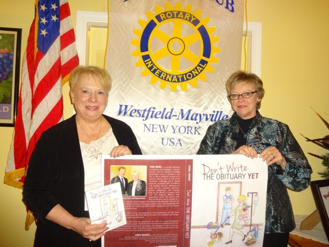 """Susan Evans (left), author and cancer survivor, was the program presenter at the Dec. 5 meeting of the Rotary Club of Westfield-Mayville at The Parkview in Westfield. Janese Berkhouse, club president, introduced Evans, who related her engaging story and had signed copies of her book """"Don't Write the Obituary Yet,"""" available for sale. Proceeds from her book sales are donated to cancer research and education."""