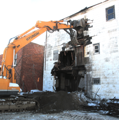 A demolition team, contracted by the Chautauqua County Land Bank, began the demolition process Thursday morning of the old Revere Inn in Silver Creek. Crews started in the back of the building and moved their way forward. The debris will be hauled off in the next couple of days. Photo by Damian Sebouhian