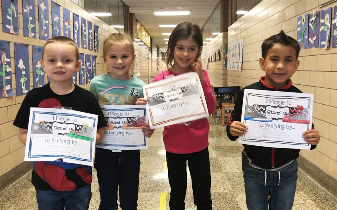 Ring Elementary School kindergartners, Jaxson Willingham, Katie Melquist, Elle Theofilactidis and Armany Carrasquillo Alvira show off the anti-bullying pledges they signed.
