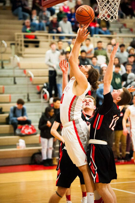 Jamestown's Marcus Rojas scores two of his game-high 25 points during Tuesday's Erie County Interscholastic Conference Division 1 basketball game against Clarence at McElrath Gymnasium. P-J photo by Valory S. Isaacson