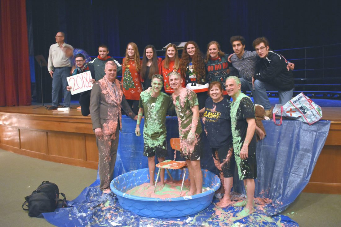 Students and staff pose after Friday's event at Jamestown High School.