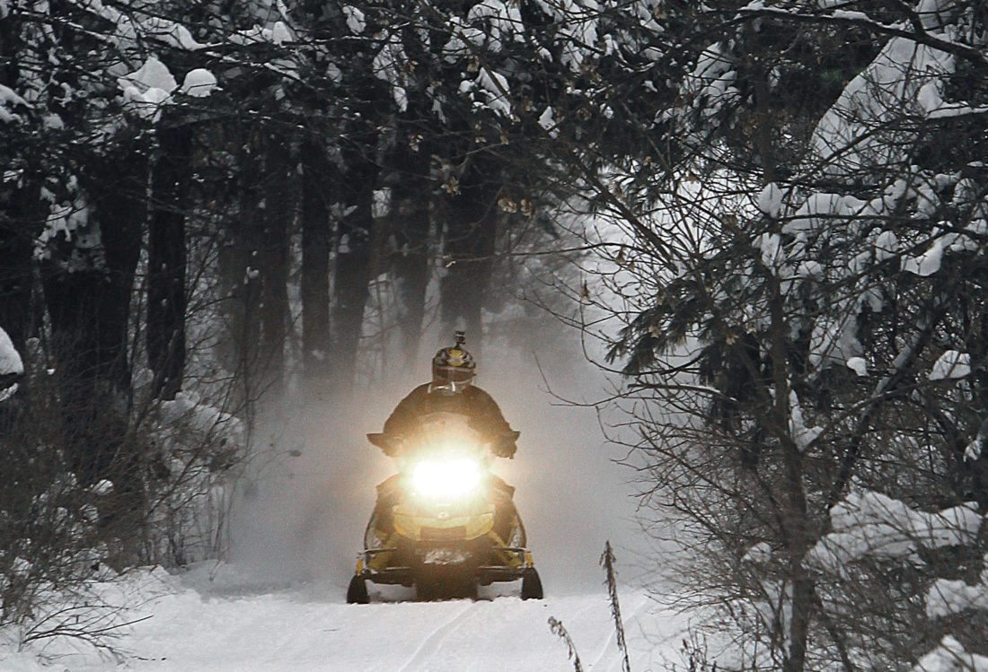 The Chautauqua Lake Snowmobile Club announced this week that four of its snow groomers are currently down, but that the majority of the county's snowmobile trails are now open for snowmobiles.  AP file photo