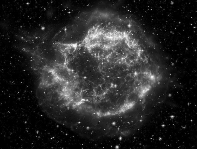 At left, supernova remnant Cas A can be glimpsed in amateur telescopes during January in the constellation Cassiopeia. This is the brightest extrasolar radio source in the sky at radio frequencies above 1 GHz.                                          Courtesy NASA/JPL- Caltech