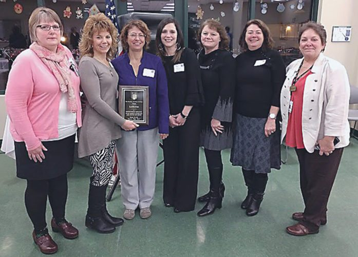 The staff from Lutheran and Cassadaga Job Corps Academy during the presentation of the job corps' Distinguished Employer Award. Pictured, from left, are Cindy Schnelzer, Katrina Jones, Desiree Mechling, Casey Gustafson, Michelle Madison, Lynn Reale and Dayna Schultz. Submitted photo
