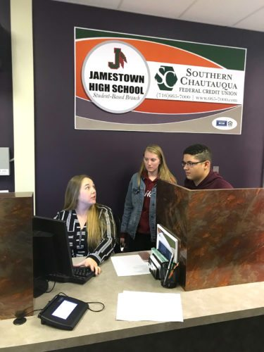 Melissa Johnson, from the Southern Chautauqua Federal Credit Union, recently worked with JHS student-interns, Hannah Frederick and Delante Jones, in the credit union's branch office located in the JHS library.