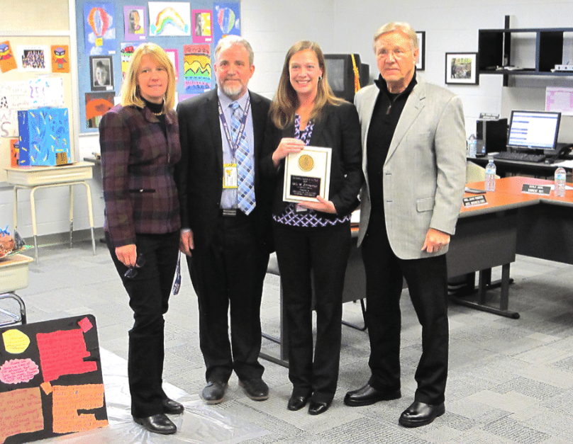 Kelly Zimmerman, Pine Valley elementary school principal holds her Educational Leader of the Year award bestowed by Niagara University's College of Education. Standing with Zimmerman are (from left to right) Chandra Foote, Dean of College Education at Niagara University; Scott Payne, Pine Valley superintendent of schools; and Dr. James Mills, supervisor of educational leadership at Niagara University.