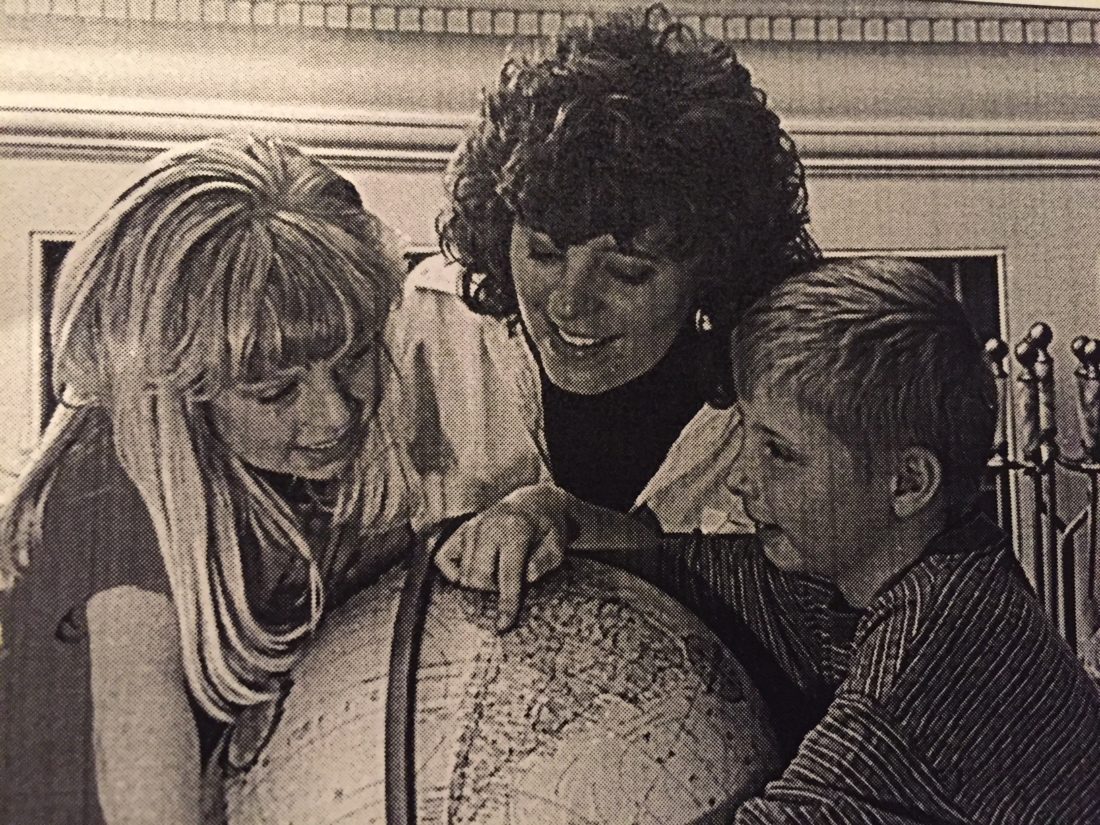 The late Jack Berger took this photo in 1998 of Sharon Stillman showing her children, Katy and Jake, where their father's newest assignment would take them.