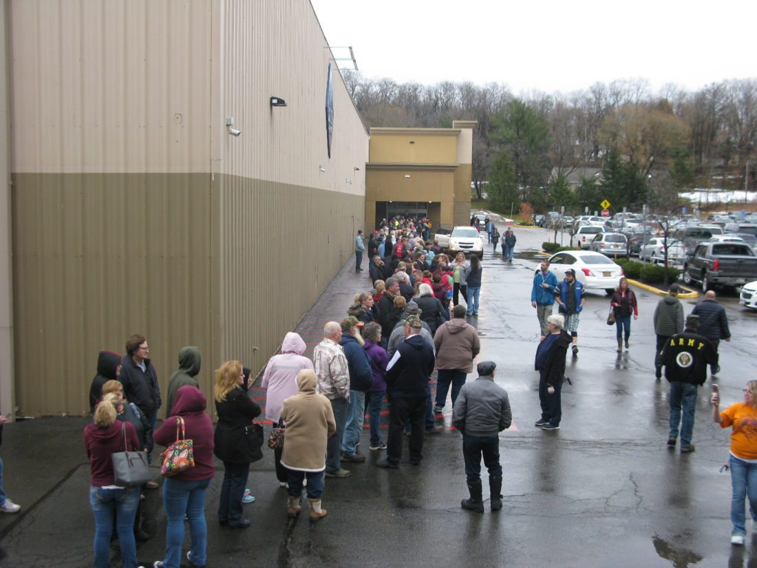 Customers line up in the front of Sam's Club on Friday morning, a day after it was announced the store would close Jan. 26.  P-J photo by Eric Tichy
