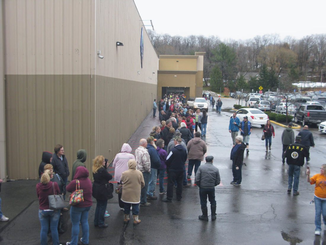A line of customers wait to enter Sam's Club on Friday morning in the town of Ellicott, a day after the store announced it would close Jan. 26. Many said they were disappointed in the sudden announcement, but were looking for good deals nonetheless.  P-J photo by Eric Tichy