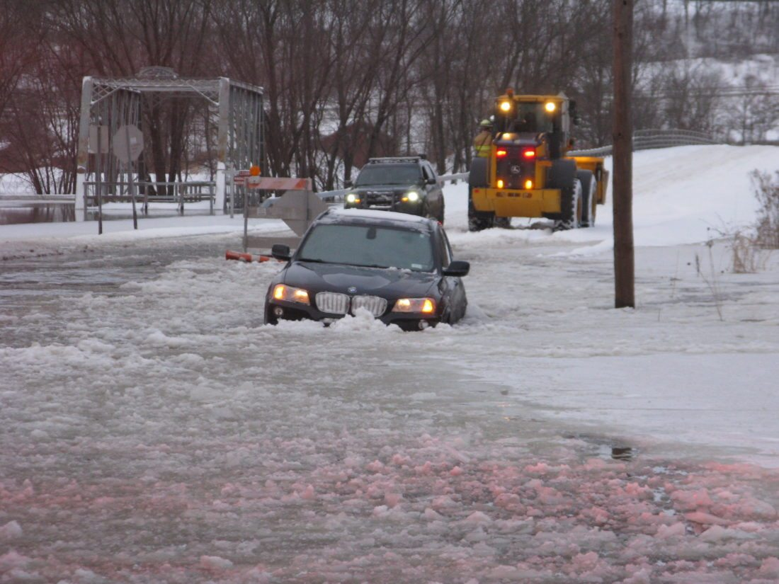 No one was reportedly injured after a vehicle became partially submerged on Water Street in the village of Falconer on Saturday.  P-J photo by Noah Rankin