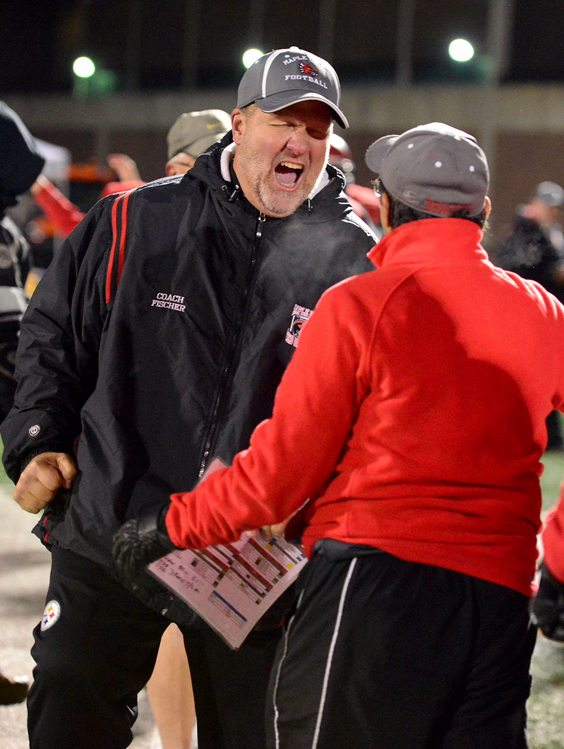 Maple Grove head coach Curt Fischer celebrates with assistant coach Dan Greco. P-J photo by Scott Reagle