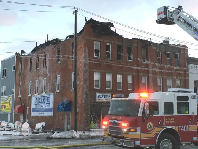 A West Main Street building heavily damaged by fire Sunday in the village of Falconer is expected to be demolished starting this morning. The building's owner, Brian Nelson, said he hopes to have debris removed from the site as quickly as possible. Nelson also owned Falconer Vacuum Shop located on the building's first floor.  P-J photo by Katrina Fuller