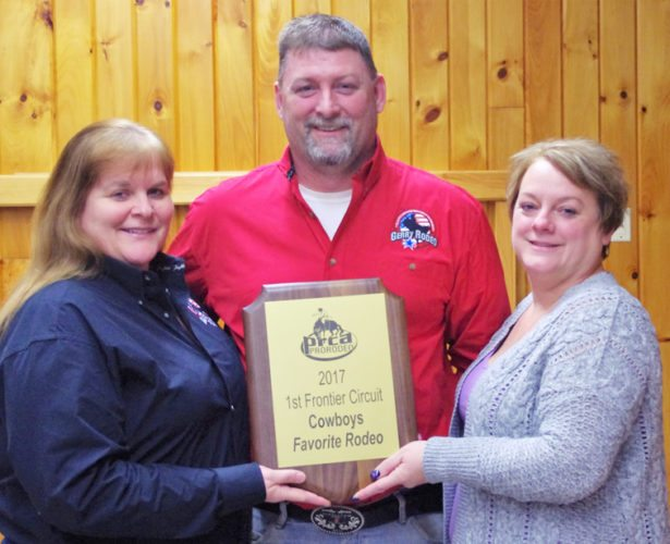 Members of the Gerry Rodeo committee display the cowboys' Favorite Rodeo award they received at the First Frontier Finals Rodeo last week. From the left are Sharon Atwell, rodeo committee secretary; Tom Atwell, rodeo chairman; and Lori Johnson, advance ticket sales chairman. Submitted photo