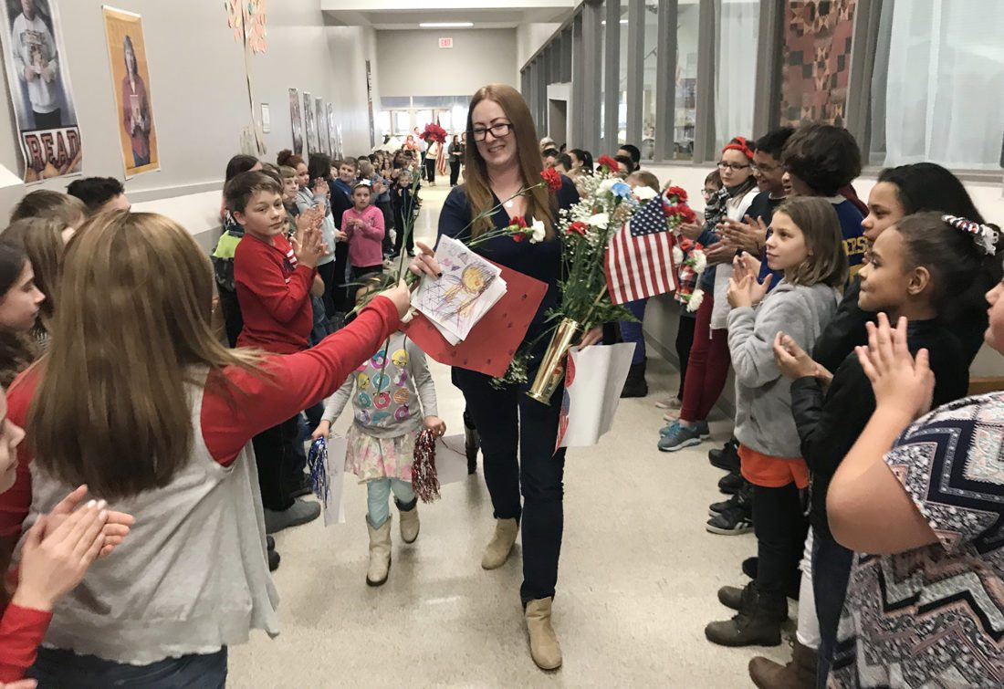Yvonne Jespersen, a health and attendance clerk at Jefferson Middle School, received a surprised send-off from the entire school. Jespersen, an Army reservist, was deployed to Kuwait on Friday. Submitted photos