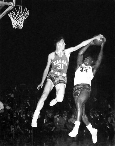 Niagara University's Clem Worosz blocks the shot attempt of Syracuse's Jim Brown during the 1950s. Submitted photo
