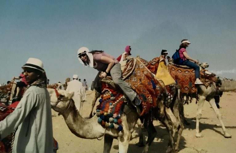 Just riding a camel  near the Giza Pyramids in Cairo, Egypt.