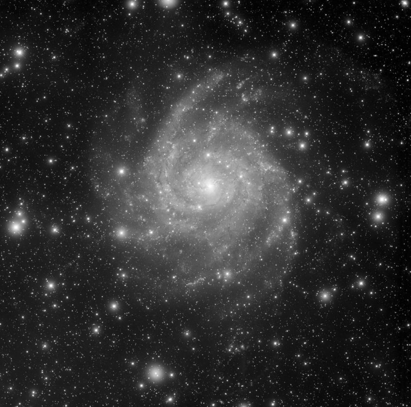 Only 10 million light-years away toward the constellation Camelopardalis lies the large spiral galaxy IC342. It would appear much brighter in our night sky but it is viewed through an intervening veil of stars and gas and dust clouds that lie along the plane of our Milky Way Galaxy. This object is quite easy to locate in a small telescope this month.       Courtesy T. Rector (U. Alaska Anchorage), H. Schweiker, WIYN, NOAO, AURA, NSF
