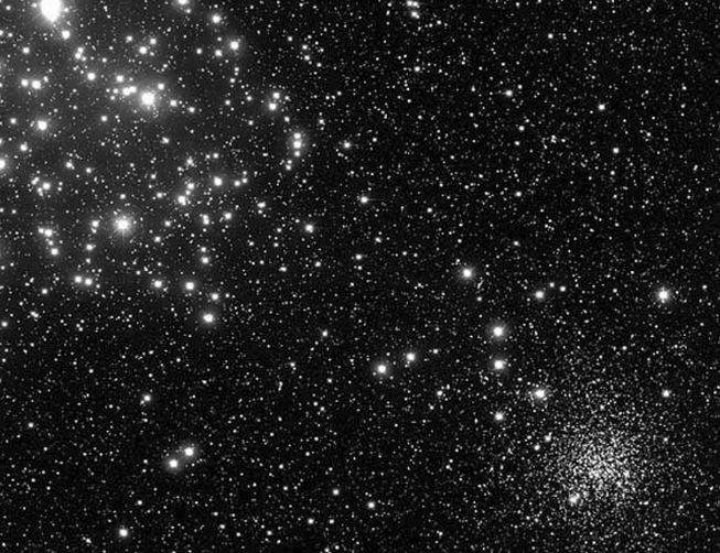 On the left in this image is the open cluster M35, a young, relatively nearby (2800 light-years) star cluster that can be viewed in small telescopes this month. On the right side is the much older and denser star cluster NGC2158, lying four times farther away in the constellation Gemini.                          Courtesy CFHT, J. C. Cuillandre