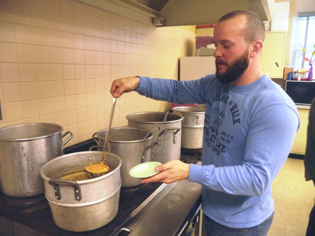 Dan Larson, Findley Lake board of trustees, ladles soup last Sunday as part of the annual soupfest event in Findley Lake. A record amount of money was raised.  Photo by David Prenatt