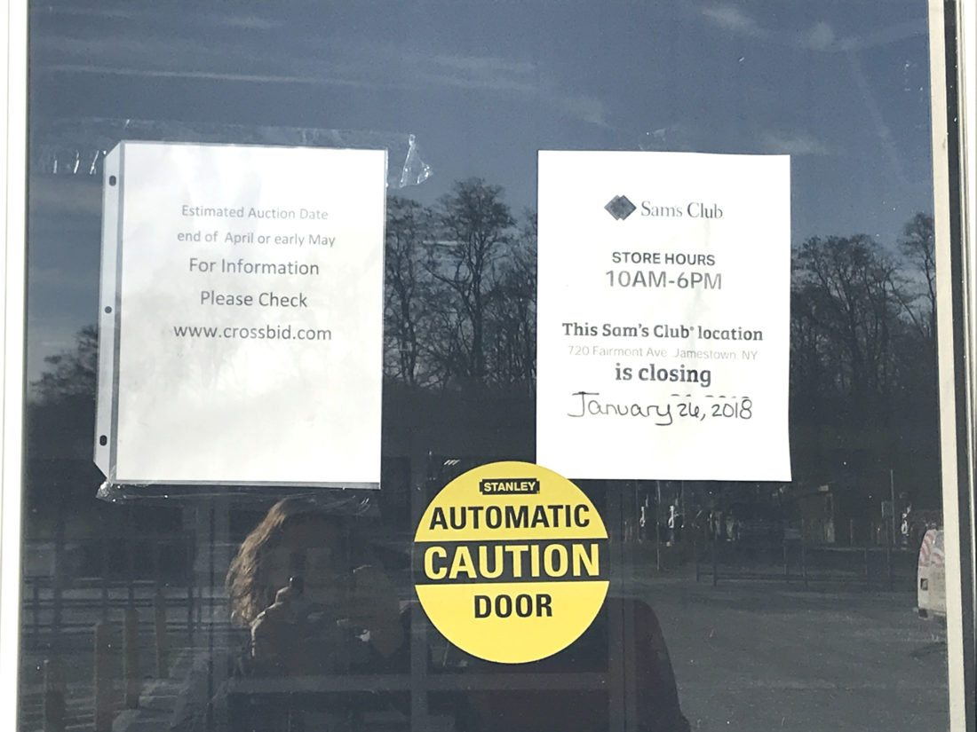 Signs are posted on the front doors at Sam's Club. An auction for equipment inside the store is scheduled to take place late April or early May.  P-Jphoto by Katrina Fuller