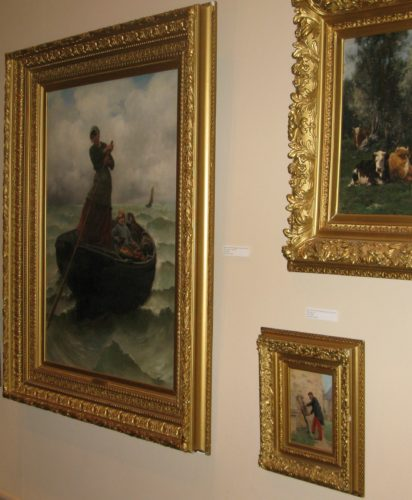 """Georges-Jean-Marie Haquette's """"The Fisherman's Wife"""" and Paul Louis Narcisse Grolleron's """"Sharpening the Knife"""" are two of the 15 Prendergast Library oil paintings available for sale today during an auction held by Sotheby's.  P-J photo by Gavin Paterniti"""
