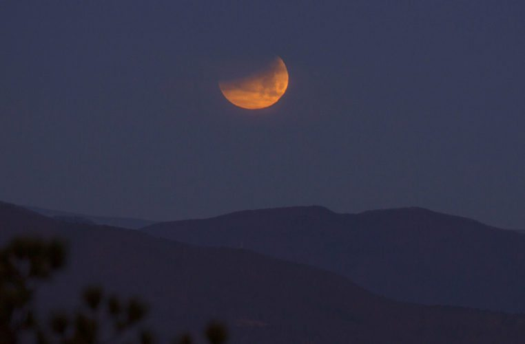 The blue supermoon eclipse sets Wednesday morning seen from Roanoke Mountain in Virginia. AP photo