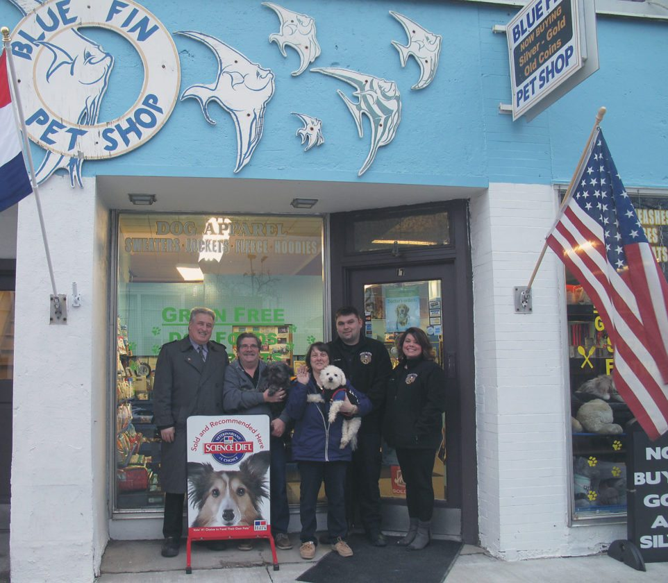 The Blue Fin Pet Shop in Falconer has reopened, much to the joy of the community. Pictured from left are Falconer Mayor James Rensel, Dan and Sylvia Magara along with their furry companions Lotto and Buddy; and Falconer Fire Volunteer Fire Department Chief Charles Piazza and his wife, Lisa, the  Falconer Volunteer Fire Department co-president.  P-J photo by Katrina Fuller