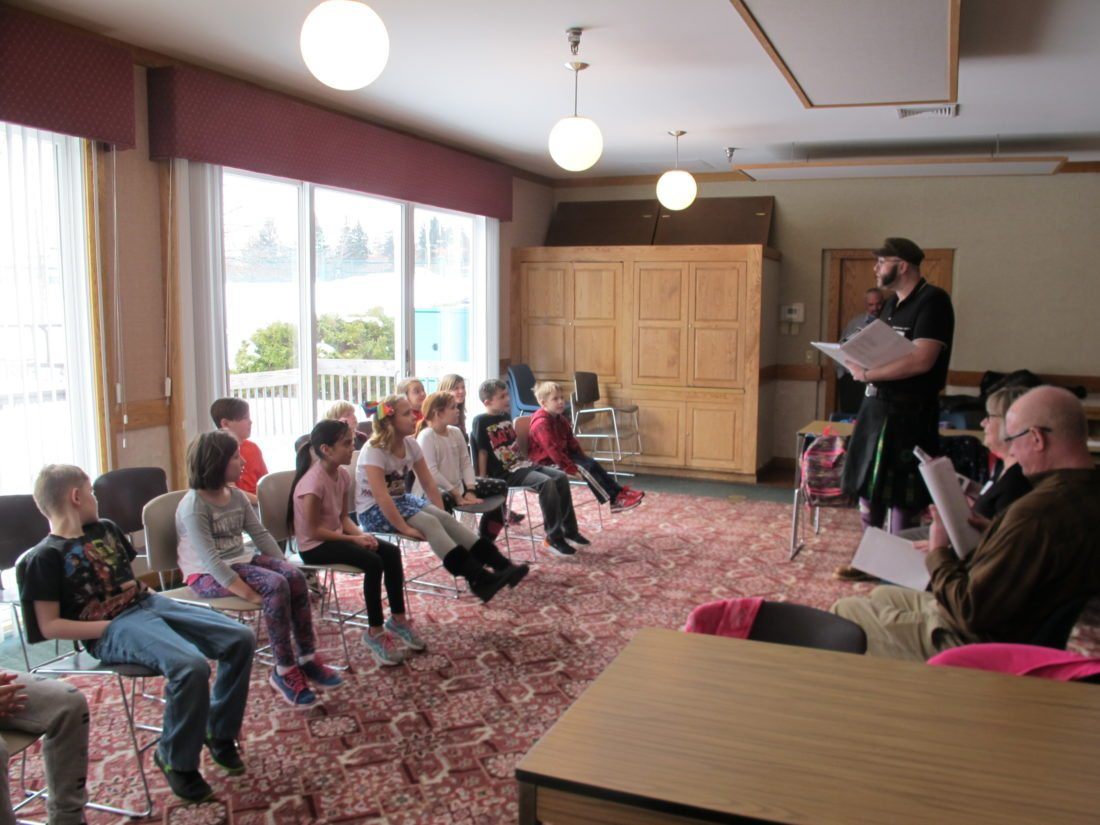 Third-graders of Westfield Academy and Central School watch as their plays are read aloud by a team of Chautauqua Institution theater staff and volunteers led by Matt Cragan. P-J photo by Gavin Paterniti