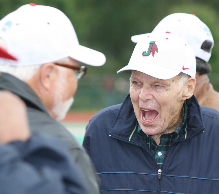 Former Jamestown High School football coach Terry Ransbury returned to the city in September 2014 for the reunion of his undefeated 1964 team. At left, he enjoys a light moment at Strider Field before a game. P-J file photo  by Scott Kindberg