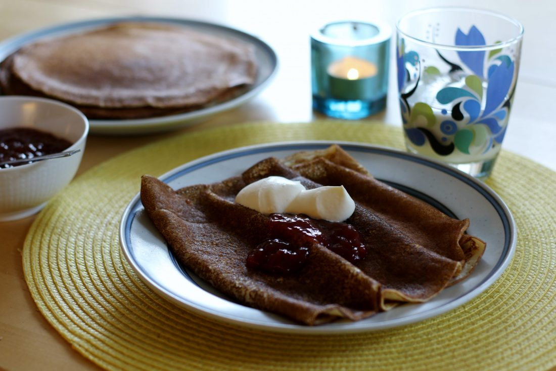 A dish of true Swedish pancakes with lingonberries and cream.  Photo by Karin Forsberg