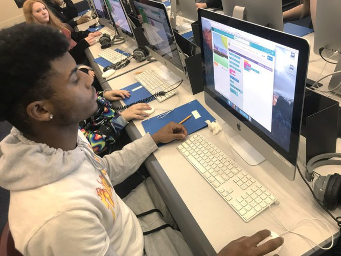 Washington Middle School eighth-grader, Travon Blakeslee, works on computer coding during Stacy Brand's Information Literary & Computers class.