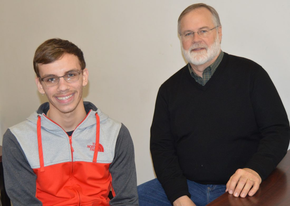 Deke Kathman, left, and Mike meet at Jamestown High School during one of their weekly mentoring sessions.
