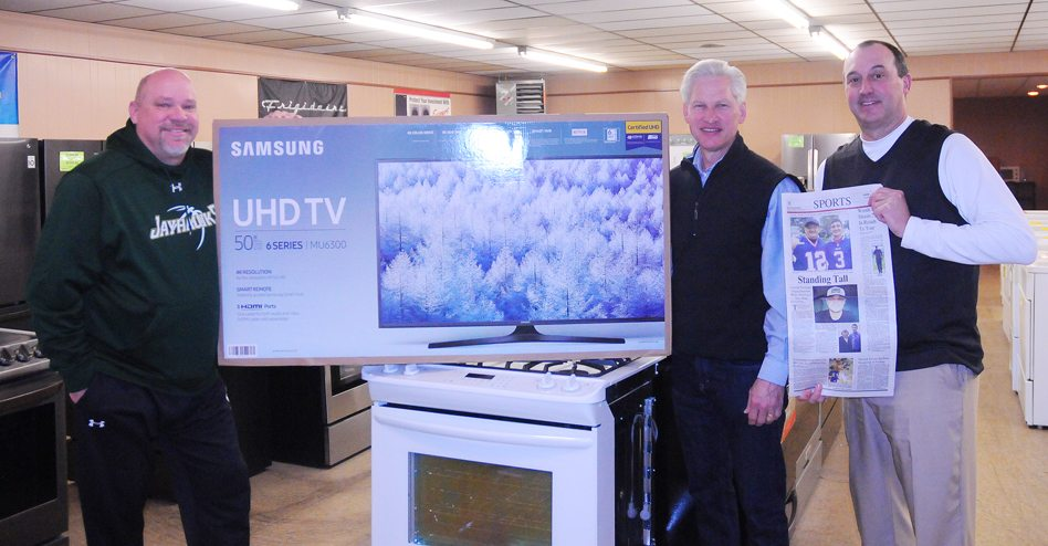 Courtesy of Dan Hocking of Acme Appliance, middle, a 50-inch Samsung television will be raffled off this month as part of Organ Donation Awareness Month at Jamestown Community College. The event, sponsored by the college, its athletic department and The Post-Journal, will begin Wednesday night when the Jayhawks women's and men's basketball teams take the floor at 5:30 p.m. and 7:30 p.m. respectively. Joining Hocking in the photo are JCC men's basketball coach George Sisson, left, and JCC athletic director Keith Martin. The organ donor awareness campaign is inspired by sportswriter Cody Crandall of Jamestown, who is awaiting a heart transplant at Strong Memorial Hospital in Rochester. P-J photo by Scott Kindberg