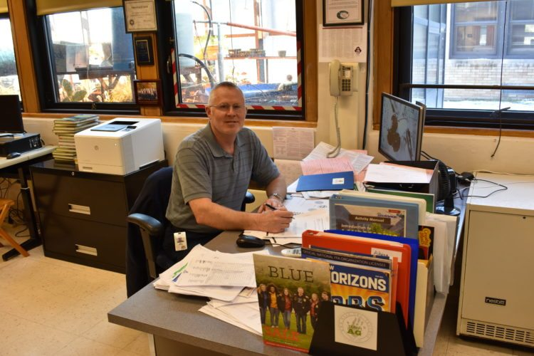 Scot Aikens, agriculture teacher at Clymer Central School, reflected on his 13 years as a teacher at Clymer and his previous life as a dairy farmer. Aikens has been head of the agriculture program for the past four years.  P-J photos by Jordan W. Patterson
