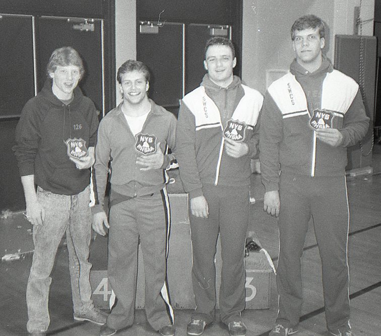 From the left, Bill Young of Randolph, Terry Green of Jamestown, PJ Wendel of Southwestern and Tom Meyers of Southwestern pose for a photo after the Section VI wrestling championships in 1988. P-J file photo