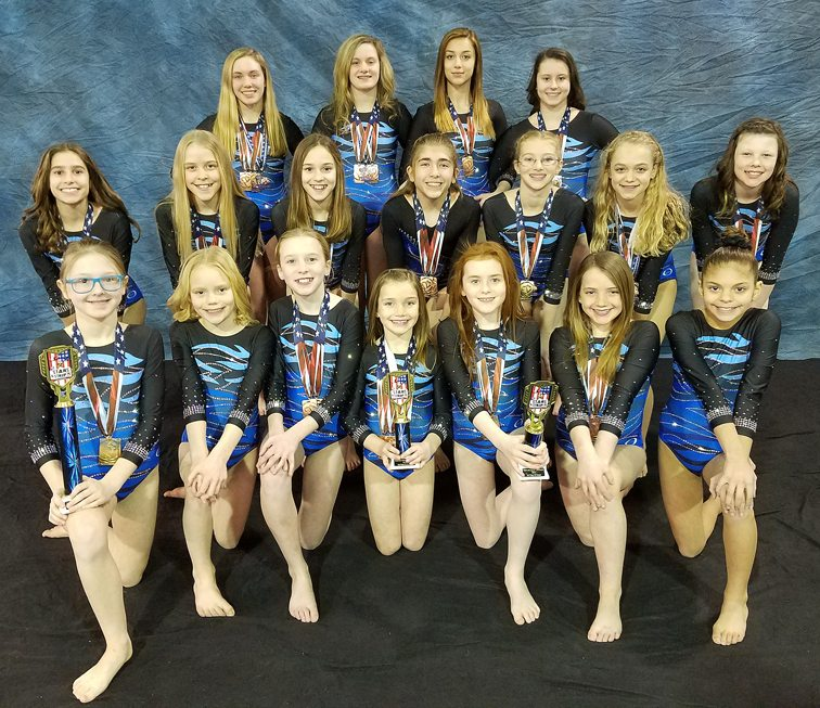 Team Flyers recently competed in the Stars and Stripes Gymnastics Invitational in Erie, Pa. and came home with plenty of hardware and medals, including a first in all-around by Level 3 Mia Volpe. Submitted photo