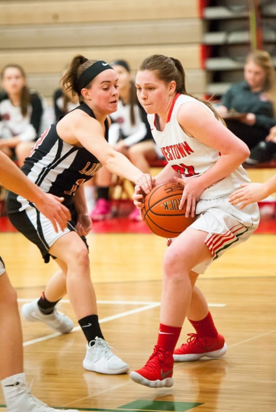 Jamestown's Kaitlyn Bennett, right, tries to get past Lancaster's Madisyn Pepke during Monday's Erie County Interscholastic Conference Division 1 basketball game. P-J photo by Valory S. Isaacson