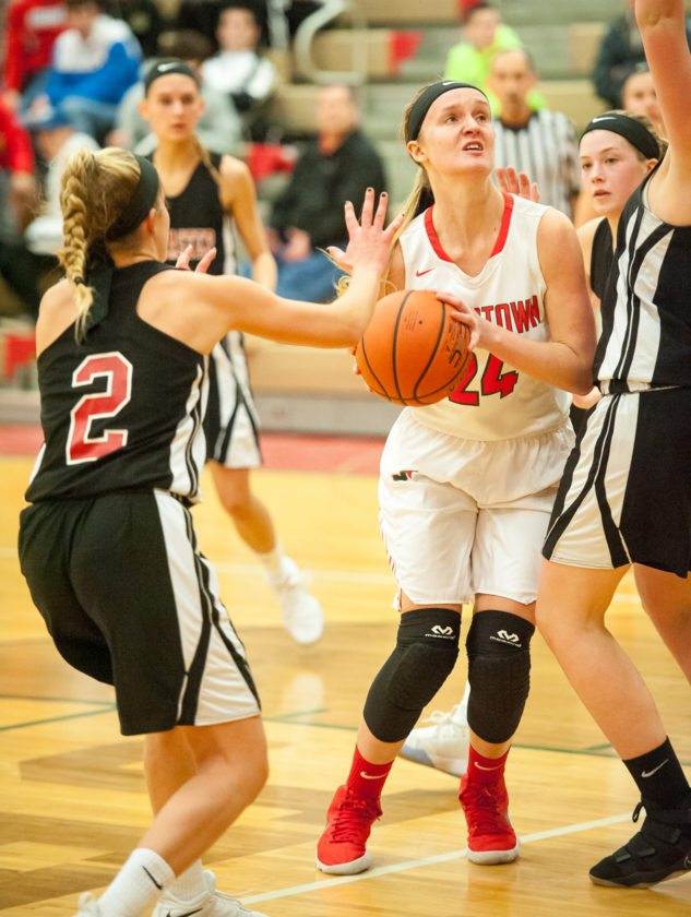 Jamestown's Morgan Brightman tries to split a pair of Lancaster defenders on her way to the basket Monday night at McElrath Gymnasium. P-J photo by Valory S. Isaacson