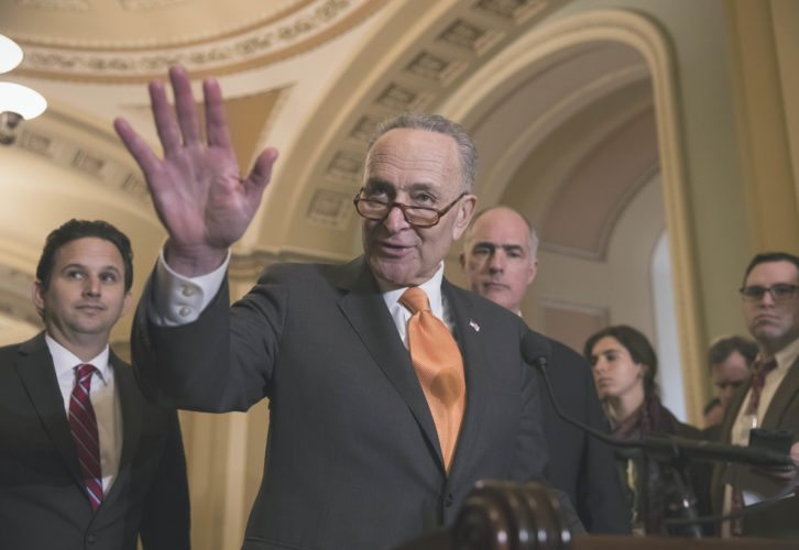 Senate Minority Leader Chuck Schumer, D-N.Y., flanked by Sen. Brian Schatz, D-Hawaii, left, and Sen. Bob Casey, D-Pa., speaks with reporters as work continues on a plan to keep the government open as a funding deadline approaches, at the Capitol in Washington, Tuesday, Feb. 6, 2018. (AP Photo/J. Scott Applewhite)