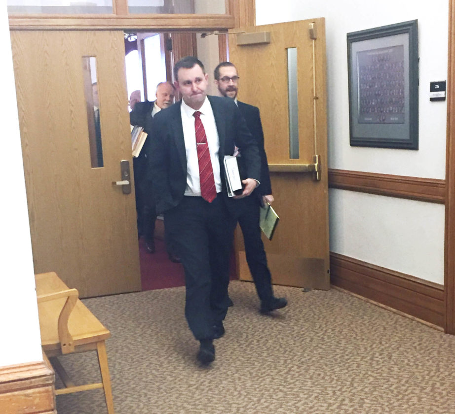 Chautauqua County District Attorney Patrick Swanson, in front, exits the courtroom in Mayville on Tuesday. Jury deliberations began in the attempted murder case against Justin Haffa.  Photo by Jimmy McCarthy