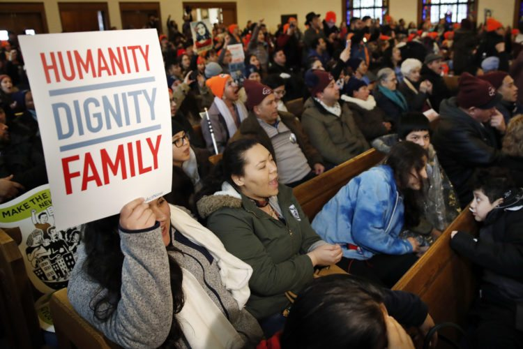 People rally in support of the Deferred Action for Childhood Arrivals (DACA) program Wednesday, Feb. 7, 2018, at the Lutheran Church of the Reformation, near the Capitol in Washington. (AP Photo/Jacquelyn Martin)