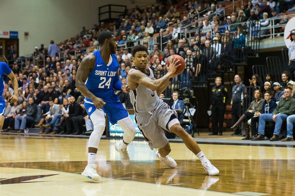 St. Bonaventure's Jaylen Adams, right, is closely guarded by Aaron Hines of Saint Louis during Wednesday's Atlantic 10 Conference basketball game at the Reilly Center. It didn't matter how the senior guard was defended, however, as he scored a career-high 44 points in the Bonnies' 79-56 victory. P-Jphotos by Tim Frank