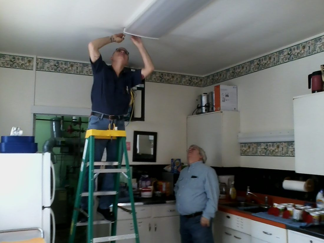 Pictured, on the ladder, is Kurt Holm of Batteries Plus Bulbs. Looking on is Jim Steber, a member of the Bemus Point Library Board of Trustees. Submitted photo