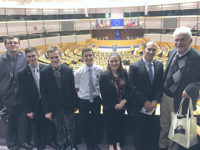 Jack Winsor, Zach Haynes, Kody Robbins, Avery Sirwatka, Sydney Kresconko, Mathew Kornacki, and Greg Rabb at SUNY Model European Union in Brussels, Belgium.