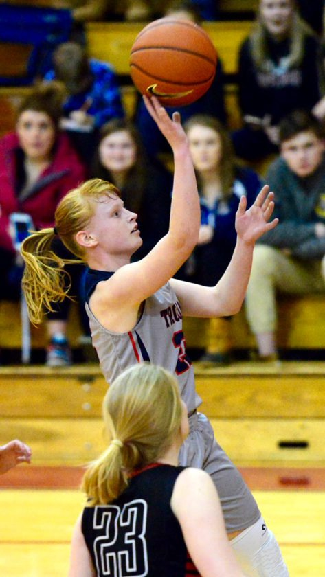 Southwestern's Erin Radack puts up a floater during CCAA Division 1 West girls basketball action against Maple Grove on Thursday at Southwestern. P-J photo by Scott Reagle