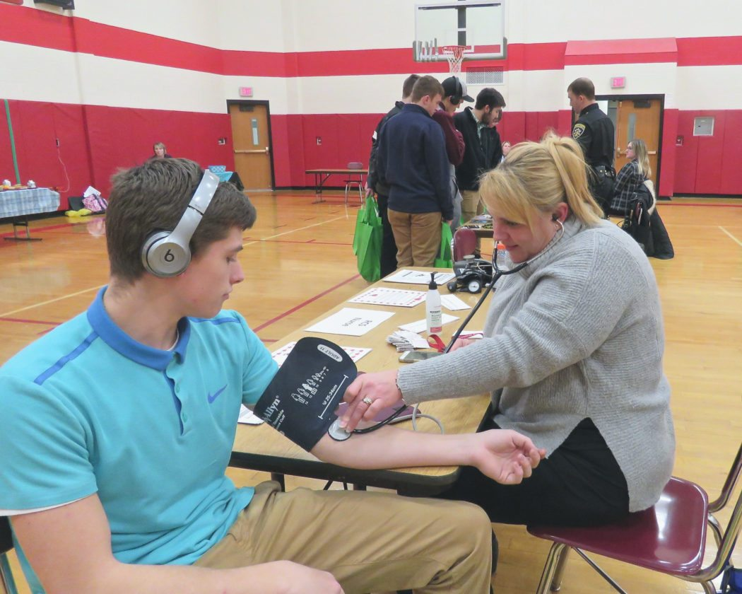 To encourage the community to take care of their physical and mental health, Randolph Central School hosted a Wellness Fair in conjunction with its Cards Against Cancer fundraising event. Shown is high school nurse, Samantha Kozlowski taking the blood pressure of Portville student, Kyle Muray. Photo by Deb Everts