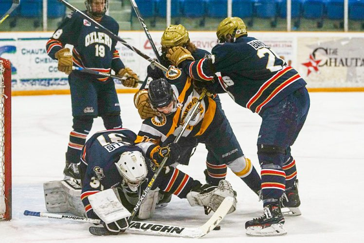 Southern Tier's Mickenzie Restle (13) is surrounded in front of the net as he attempts to poke the loose puck into the net during Sunday's North American Tier IIIHockey League game at Northwest Arena.  P-J photo by Chad Ecklof