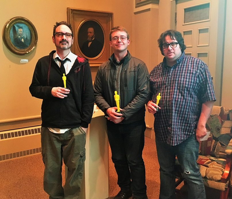 """Pictured is Prendy Award winner Matthew Swanson (center). Prendy Jr. winners are Shane T. French (left) and Joshua A. Latona (right). Not pictured is Steve Johnson, who won the Prendy Award with Swanson, and Arran Carlson, who won a Prendy Jr. award for """"Rebel Scum.""""."""
