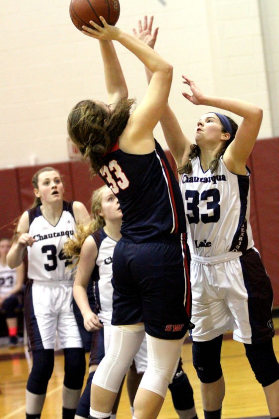 Southwestern's Alanna Dibble, left, is defended by Chautauqua Lake's Lily Woodis, right, during their CCAA Division 1 West girls basketball game Monday in Mayville. P-J photo by Lisa Monacelli