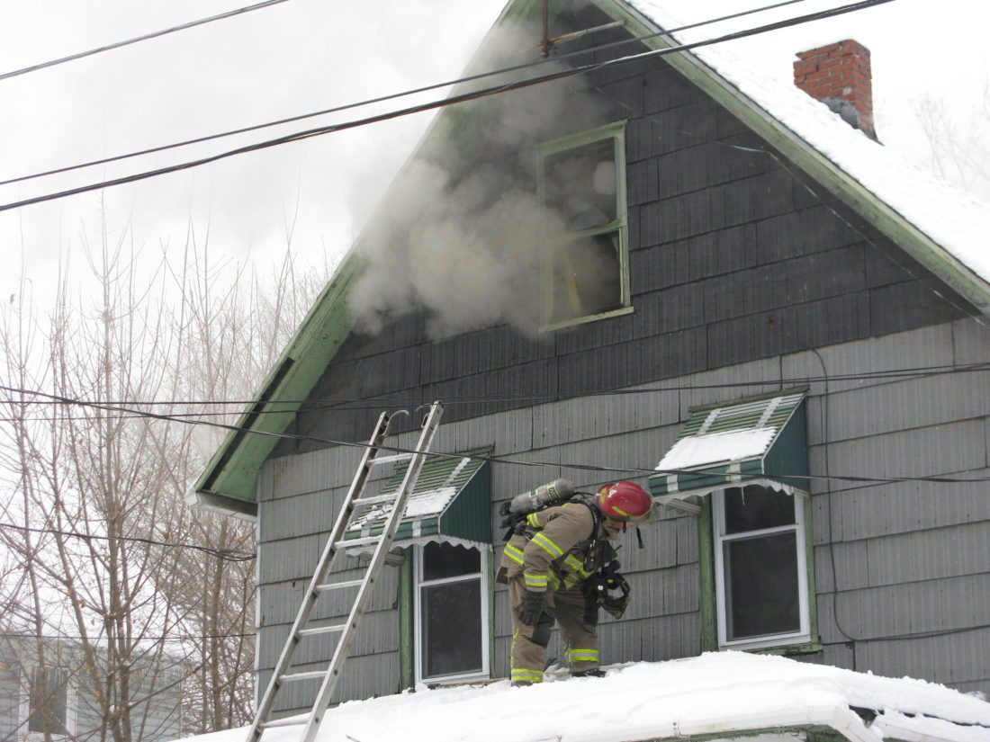 A cord connected to a space heater is believed to have sparked a blaze that heavily damaged a Flagg Avenue residence Friday in the city of Jamestown. No injuries were reported in the fire.  P-J photo by Eric Tichy